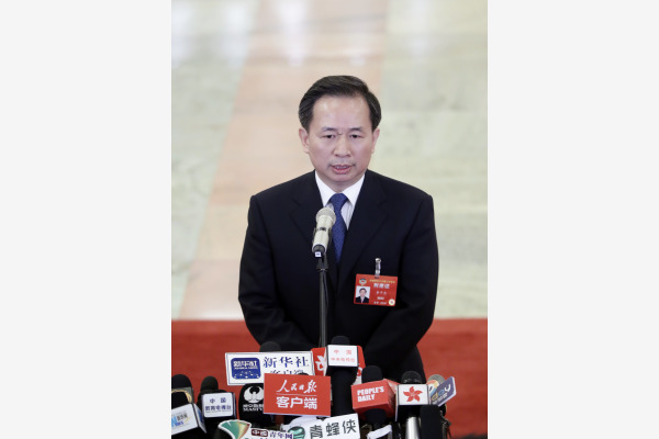 """生态环境部部长李干杰在""""部长通道""""接受采访。本文图片均由新华社供图"""
