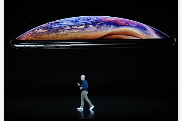 苹果公司在硬件上的革新与营收都显得增长乏力。新华社资料图