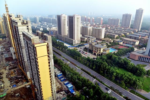 位于《攻坚走动方案》实施周围的江苏省宿迁市城市景不都雅。摄影/章轲