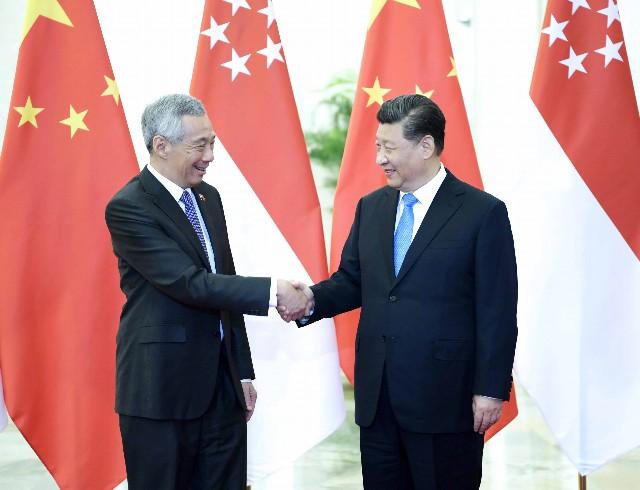 4月29日,国家主席习近平在北京人民大会堂会见新加坡总理李显龙。